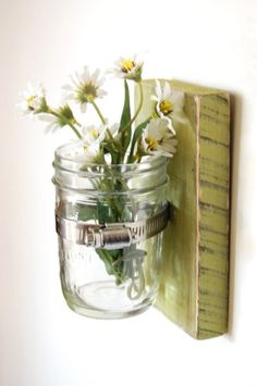 Recycled jar into a flower wall vase.