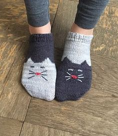 These are two-toned, toe-up ankle socks with a kitty chart on the toe and foot. They feature a simple short-row heel. They can be made Yin and Yang style with contrasting colors or two-of-a-kind. This is my first foray into design and I had a lot of fun. Feel free to contact me with any issues!