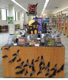 "Schimelpfenig Library October 2013 Adult Display ""It Came From The Library"". Bats for a Halloween display! School Library Displays, Middle School Libraries, Elementary School Library, School Library Themes, Library Work, Library Ideas, Library Signs, Photo Library, Halloween Displays"