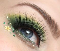 Pretty green eye shadow with glitter and crystal accents... and a tiny flower too.