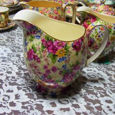 """Royal Winton Grimwades """"Cheadle"""" 5 1/2"""" Jug   A Royal Winton design first introduced in the 1930s and continued through to the 1950s. Named after the market town in Staffordshire, Cheadle has summer flowers in pink, yellow and white, with small blue harebells and cerise buds on a creamy ground."""