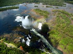 Everyone should see Iguazu Falls in person, but if you can't make it to South America just yet, these photos should tide you over. Iguazu Falls, Roadside Attractions, Photo Essay, South America, Beautiful Places, Around The Worlds, Waterfalls, Awesome, Travel