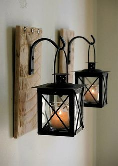 These vintage DIY metal lanterns turned candle stands can never get old-fashioned. Its unique and artistic. The rustic wooden piece nailed in the wall carrying these lanterns with candles creates a magical environment in your home.