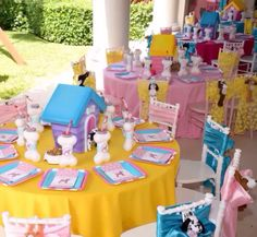 #tablescape Puppy Themed Birthday Party. Gorgeous puppy boutique dessert store front, life size puppy houses for the relay races and puppy house centerpieces all custom made by #bambinisoiree.