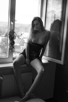 women in the window. Hot outside hot inside