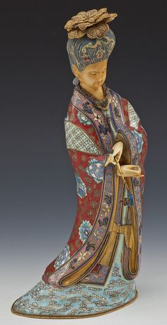 """Chinese cloisonne and ivory figure of a lady holding a sceptre. Elaborate robes of cloisonne enamel on gilt brass with carved and polychrome ivory hands and face. Seal mark under base. MEASUREMENTS: 12"""""""
