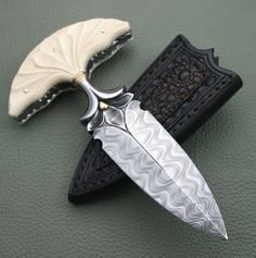 Damascus Steel push dagger, with carved blade and ivory grip. Damascus Blade, Damascus Knife, Damascus Steel, Swords And Daggers, Knives And Swords, Dagger Knife, Knife Art, Cool Knives, Arm Armor
