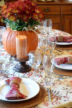 Simple Thanksgiving Table Idea. Flowers in the pumpkin, good idea!