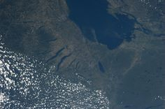 """""""Upstate New York.  Lake Ontario feeding the St. Lawrence River and the Finger Lakes.  Karen Nyberg from space."""""""