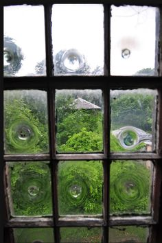 BullsEye   glass Panes Britain made from the bottom of broken bottles.  Amazing
