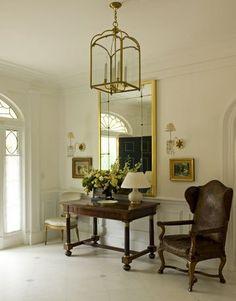 entryway, lantern light fixture, large mirror,