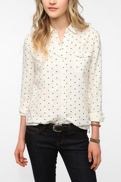 I have this shirt from Urban Outfitters; I wear it with bright red accessories and nails and navy sailor pants.