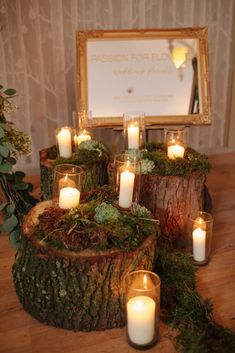 Tree Stumps, Candles, Moss, Rustic Ladders - Woodland rustic wedding ceremony in barn venue with woodland arch made from moss, eucalyptus, succulents
