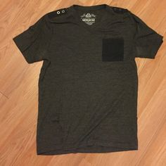 American Rag Men's Black and Gray Tee. Size S American Rag Men's Black and Gray Tee. Size small. Lightly worn. Two black buttons on top of shoulders. Black front left breast pocket. No holes. American Rag Tops Tees - Short Sleeve