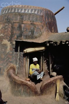 Africa | Man Sitting at Entrance to Painted Hut. Burkina Faso | © Margret Courtney - Clark