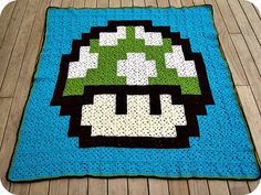 Crochet granny square 1-up Mushroom Mario, I am going to be making a lot of new blankets soon...this is awesome!