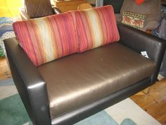 Bespoke Retro sofa with the frame/arms & base seat cushion covered in two different shades from KirbyDesign's Laser Metallic collection.  Severe contract quality fabric (100,000 rub test)  made up of 50% Polyurethane; 30% Polyester and 20% cotton.  Just use a damp cloth to wipe clean.