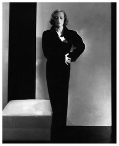 Photo Edward Steichen image appeared in Vogue's October 15, 1932 issue and features Joan Crawford in a black velvet Schiaparelli evening gown
