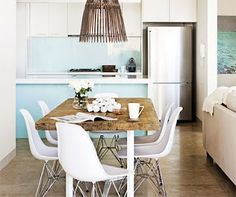 rustic dining table with eames chairs