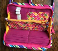 How do you like this bright & cheery Walkabout Wallet that Alma Lou Annab made? She said her quilting group did a lesson on flying geese & the blocks were the perfect size to use for her wallet's exterior!   May 2017 Handbag of the Month | Studio Kat Designs