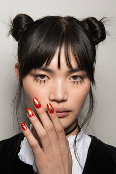 Miss Pop and CND were the brains behind the enviable long red talons at Jeremy Scott. Some models sported plain glossy red nails, while others got the star treatment (literally) with this bold gold design.
