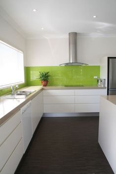 This zesty lime green kitchen splashback is a welcome contrast to the otherwise monochrome design - and it looks easy-to-clean, too! Lime Green Kitchen, Green Kitchen Decor, New Kitchen, Kitchen Decorations, Blue Backsplash, Beadboard Backsplash, Modern Kitchen Design, Kitchen Designs, Kitchen Backsplash