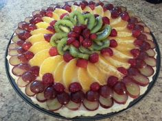 Fruit Pizza with grapes, fresh orange, kiwi, strawberries on a gluten free cookie mix crust with cream cheese mix and clear glaze!
