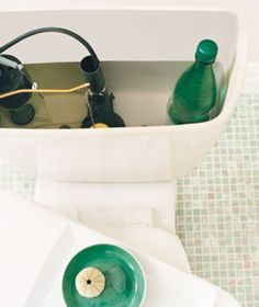 Displace water in your toilet tank with a filled plastic bottle. | 46 Penny-Pinching Ways To Save A Lot Of Money This Year