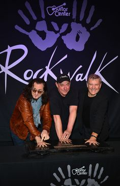 Geddy Lee Photos - Rush (L-R ) Geddy Lee, Neil Peart, Alex Lifeson, Honored On Guitar Center's RockWalk at Guitar Center on November 2012 in Hollywood, California. - Rush Honored On Guitar Center's RockWalk Great Bands, Cool Bands, Rush Quotes, Wisdom Quotes, Rush Music, A Farewell To Kings, Rush 2, Rush Band, Geddy Lee
