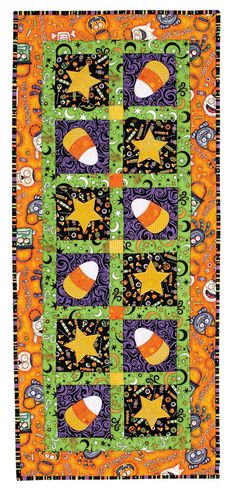 Fabrics in a trick-or-treat theme are the perfect choice for this easy-to-make table topper with its candy corn and star appliqués. Digital pattern and kit available!