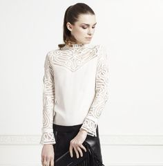 The REGENCE blouse is truly a work of art - as if it were created for royalty, this Victorian style silk blouse features intricate embroidery made from silk ribbon, long sleeve open tulip cuffs and embroidered open yoke. For the finishing touches; ANNE has designed this piece with an embroidered mock turtleneck accompanied with a button up placket at the back neckline. The REGENCE blouse is one of the newest additions to the ANNE FONTAINE Precious Collection.