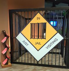 Sign with jail for Monopoly themed event.