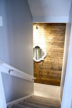 Wood accents - ideally with some highlight lighting - for warmth and coziness in the basement - but don't overdo it - basements are already dark!
