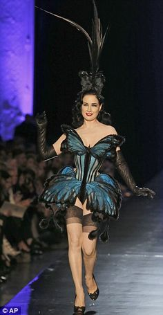 Dita Von Teese becomes a burlesque butterfly to close Jean Paul Gaultier's showgirl-inspired couture show in Paris  Read more: http://www.dailymail.co.uk/femail/article-2544026/Dita-Von-Teese-burlesque-butterfly-close-Jean-Paul-Gaultiers-showgirl-inspired-couture-Paris.html#ixzz2rC7xm1bc  Follow us: @MailOnline on Twitter | DailyMail on Facebook