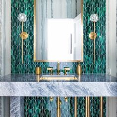 LOVE the tile, such a beautiful color and a bit more unusual tin tile shape. these colors for the hallway bath. --This vanity feature wall makes a striking statement with Malachite glass set in our new Triangulum pattern. Design by Deborah Walker,… Art Deco Bathroom, Bathroom Vanity Lighting, Gold Bathroom, Vanity Decor, Simple Bathroom, Bathroom Interior Design, Interior Design Living Room, Interior Colors, Interiores Art Deco