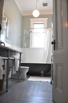 Modern finishes in traditional style w/ herringbone floors and subway tile, claw foot tub, and full shower. Love!