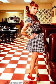 So I've got a solid pink 50's diner lookin' dress that comes complete with a little black apron. Just add roller skates? Or pink heels? Matching hair and cotton candy optional.