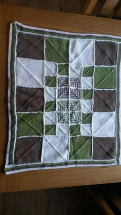 My first attempt at mitred squares. I even joined the squares up by crocheting them together another first for me too.