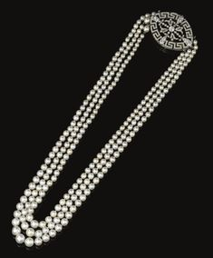 Natural pearl and diamond necklace. Set with three strands of natural pearl measuring from approx. to mm, to an open work clasp of ribbon and meander key design millegrain set with rose, single cut and circular cut diamonds. Edwardian or Edwardian style Pearl And Diamond Necklace, Pearl Jewelry, Indian Jewelry, Antique Jewelry, Fine Jewelry, Jewelry Necklaces, Pearl Diamond, Jewlery, Art Nouveau