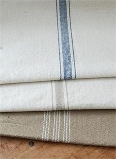 Whether you're making farmhouse style pillows, a rustic farm tablecloth or reupholstering a chair, our Feed Sack Fabric will inspire you. This feedsack fabric has been reproduced to give it plenty of vintage style and it always looks relaxed and elegant. Each style has the look of well-worn grain sack material which offers French country charm. Ticking stripes give each style pure farmhouse character. Vintage style farmhouse decor never looked so appealing.