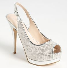 GUESS Glenisa Ivory Multi Leather Sling Back Pumps BRAND NEW GUESS Glenisa Ivory and Silver Multi Leather Sling Back Pumps.  A chic slingback will class up any look. Guess features the Glenisa, a sleek sandal with a 1 1/2 inch double stacked platform and 5 1/2 inch heel covered in an ivory croc print. An adjustable ankle strap creates a perfect fit to this striking peep toe.  Shoe Details:  Man Made Upper Man Made Sole Made In China This Shoe Fits True To Size. Guess Shoes Heels