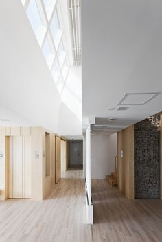 blonde wood + white galore + amazing light & ceilings