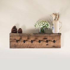 ~~~~~~ DESCRIPTION ~~~~~~~ This rustic wall rack is handmade with reclaimed barn wood, with shelf and six hooks made from authentic railroad spikes. A wonderful addition to your living room, entry hall or any space youd like to add a special rustic touch. Rack can be used to hang sweaters, hats, towels, bags and much more! ~~~~~~ DIMENSIONS ~~~~~~~ Approximate dimensions: With shelf - 30 (w) x 8 (h) x 4(d) Without shelf - 30 (w) x 8 (h) ~~~~~~~~~ NOTES ~~~~~~~~~~ This item can be made t...