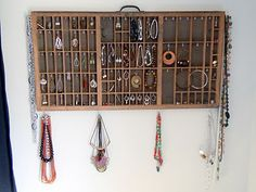 I turned an old letterpress type tray into a wall-hanging jewelry organizer and display! It took quite a while to complete