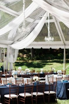 A clear-top tent takes your outdoor wedding to the next level. How beautiful is this space? The chandeliers give the reception tent an upscale feel—perfect if you're having a formal garden wedding. Outdoor Wedding Reception, Tent Wedding, Wedding Reception Decorations, Wedding Themes, Wedding Table, Dream Wedding, Reception Ideas, Wedding Designs, Rustic Wedding