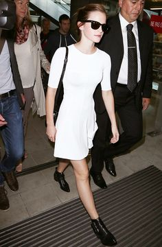 Emma Watson wearing a white dress with black ankle boots
