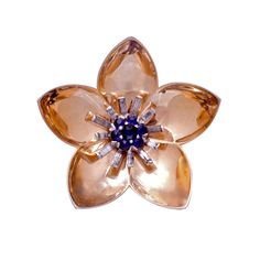 A Stunning Retro Sterling Silver Gilt Fur Clip by Mazer Bros. The Flower form brooch with individually prong set faux sapphire and diamond pastes beautifully mimics the fine jewelry of the Era.