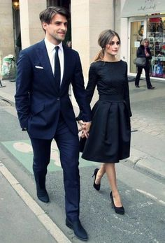 57da27f55f84 sharply dressed couple walking hand in hand, dark blue suit, white shirt  and black