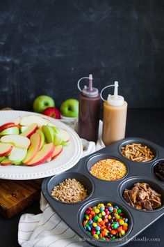 Caramel Apple Nacho Bar What a fun idea for a fall festival or Halloween Party! A Caramel Apple Bar can come together in just minutes and give your guests that wow factor! Caramel Apple Bars, Caramel Apples, Fall Recipes, Holiday Recipes, Soirée Halloween, Halloween Festival, Halloween Party For Kids, Halloween Party Foods, Halloween Recipe