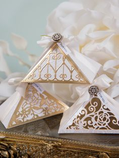 This triangle box makes the perfect gift, check out today's step by step tutorial to learn how to make this ornate embellishment. http://www.spellbindersblog.com/rouge-royale-fretwork-box/?utm_campaign=coschedule&utm_source=pinterest&utm_medium=Spellbinders&utm_content=Rouge%20Royale%20Fretwork%20For%20You%20Box